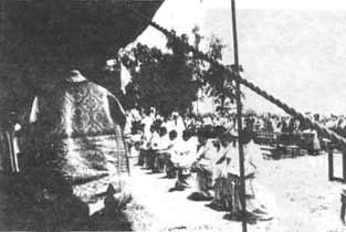 Mgr. de Castro Mayer approaching the line of eight ordinands
