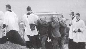 [Image: chauffeurs_carry_Lefebvres_coffin.jpg]